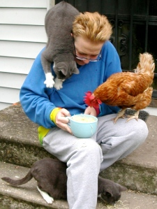 pattrice jones with Franny the hen and cats Pearl and Pyjama.