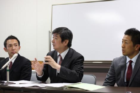 Greenpeace activists Junichi Sato and Toru Suzuki with their lawyer, Yuichi Kaido, at a press briefing.